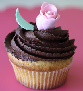 vanilla cupcake with rose topper