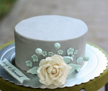 customized powder blue with white rose wedding cake