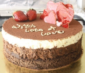 gourmet chocolate cake top with strawberries