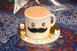 coffee cup with mustache birthday cake design