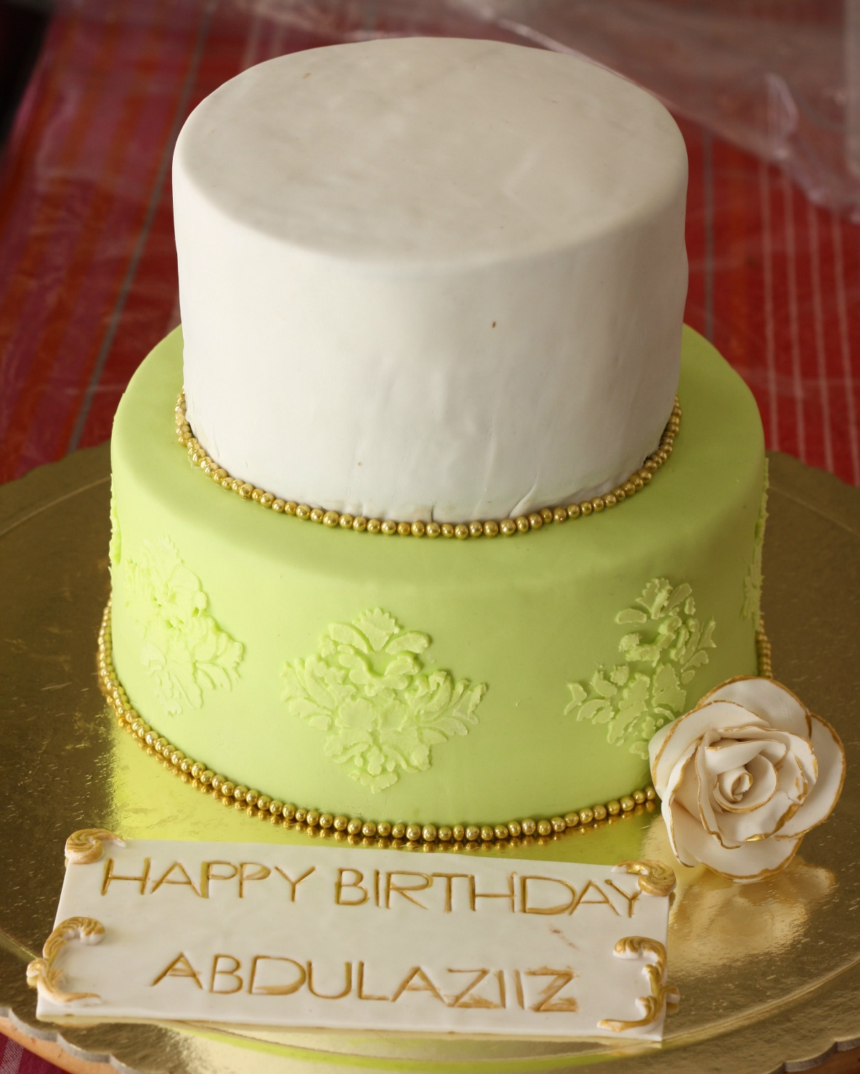 yellow and white personalized double deck birthday cake for abdulaziiz