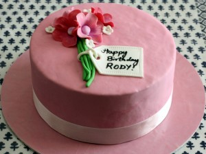 pink with flower personalize birthday cake