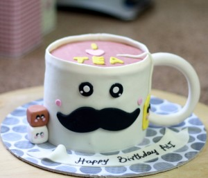 tea cup with mustache birthday cake design