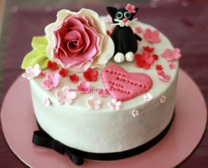 customized birthday cake top with rose and cat
